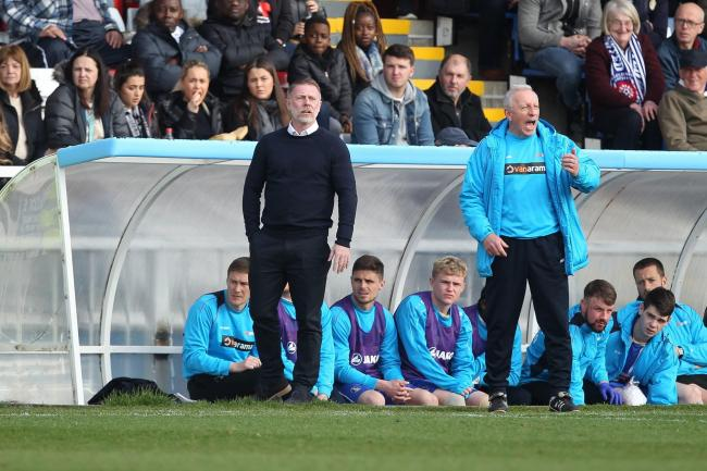 COACHING TEAM: Sweeney, seated left, with Craig Hignett and Ged McNamee