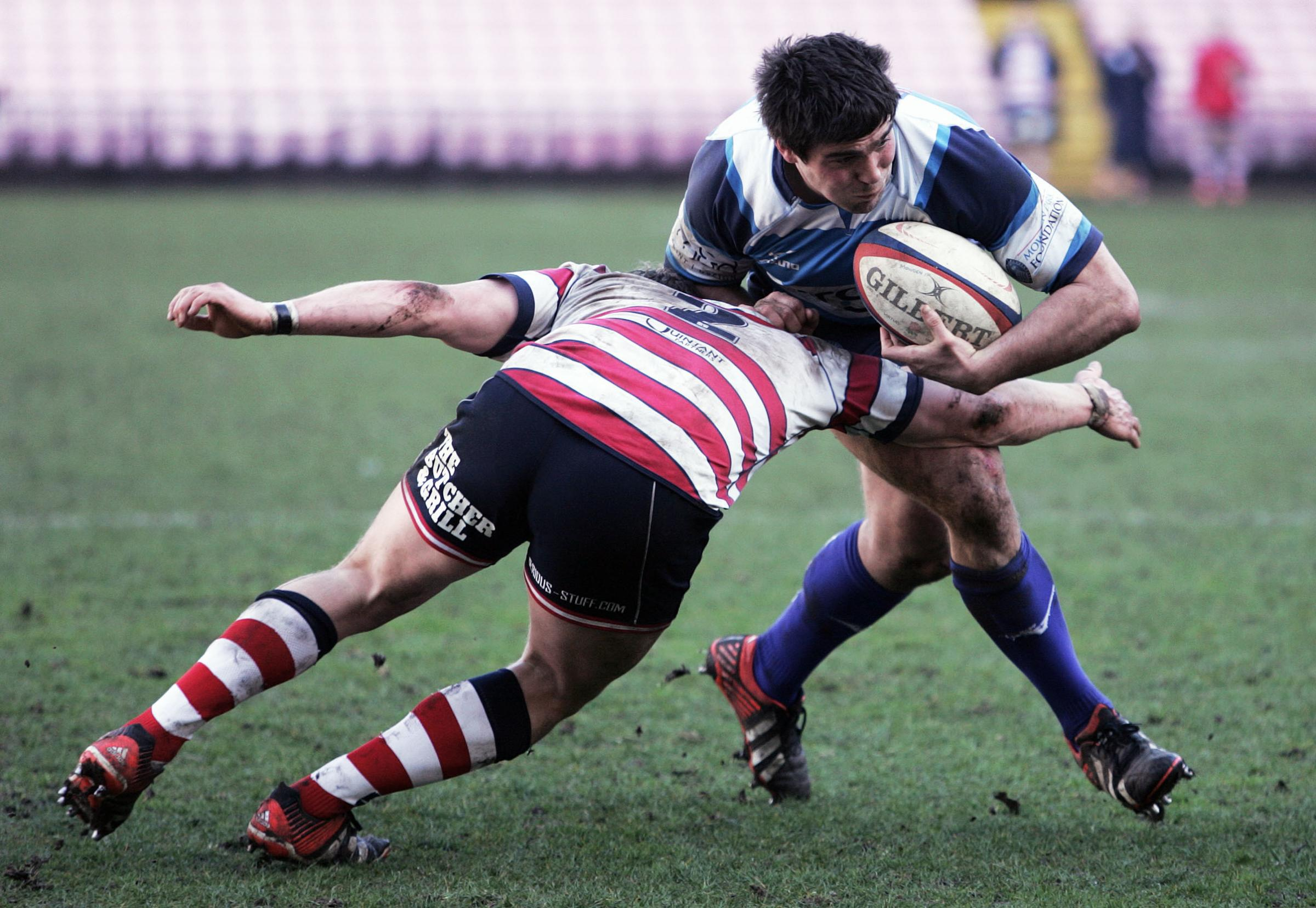 RUGBY:  Mowden's Ralph Appleby is tackled by Thomas Woolstecroft. Picture: STUART BOULTON..