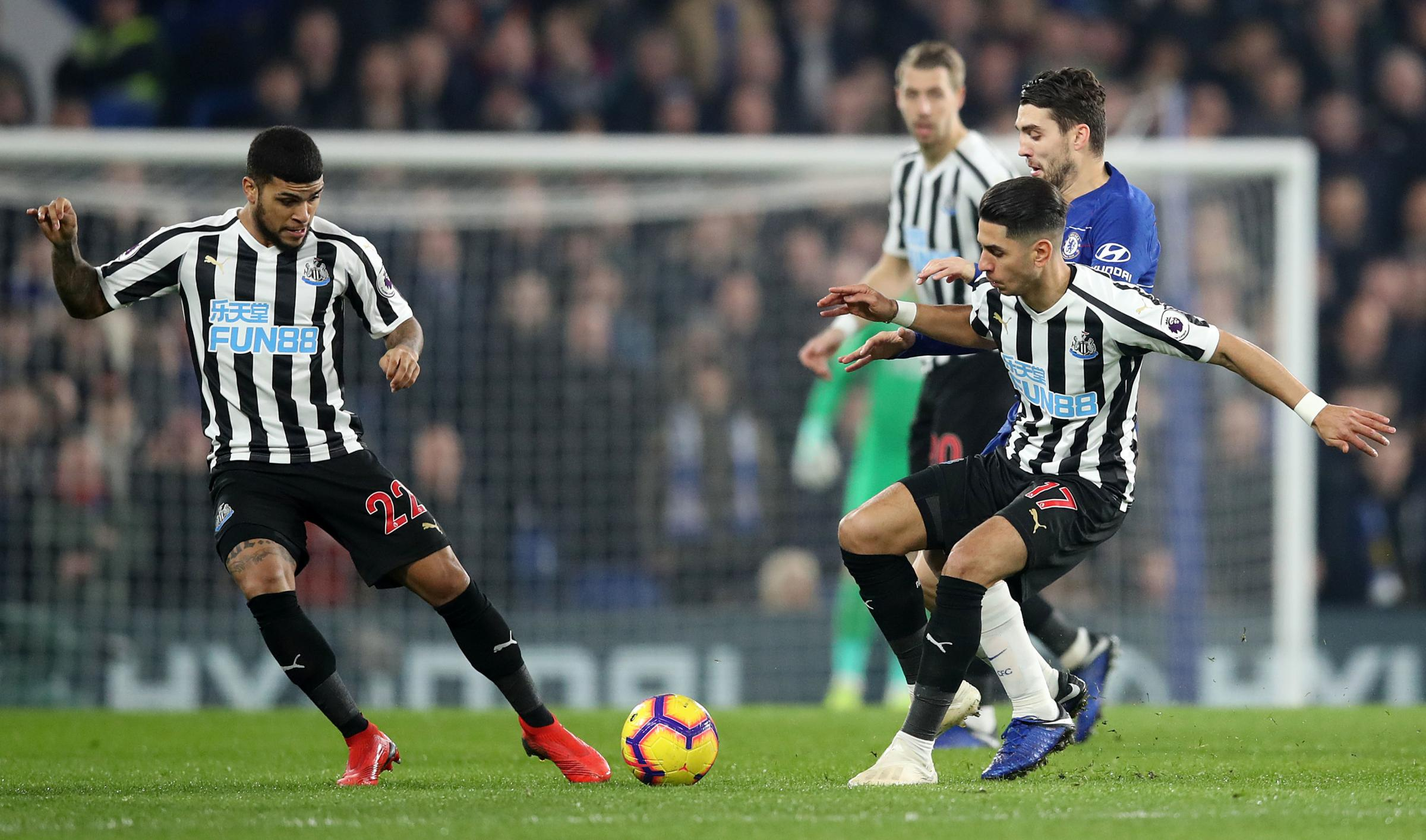 Newcastle United's Ayoze Perez (right) passes to team-mate DeAndre Yedlin during the Premier League match at Stamford Bridge, London. PRESS ASSOCIATION Photo. Picture date: Saturday January 12, 2019. See PA story SOCCER Chelsea. Photo credit should re