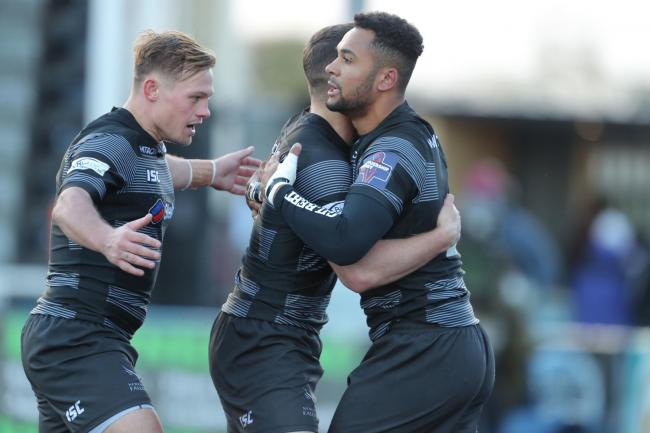 Newcastle Falcons Zach Kibirige is congratulated after scoring with Sam Stuart and Adam Radwan during the Premiership Rugby Cup match at Kingston Park, Newcastle. PRESS ASSOCIATION Photo. Picture date: Sunday October 28, 2018. See PA story RUGBYU Newcastl