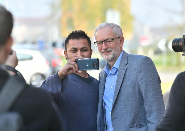 Labour leader Jeremy Corbyn poses for a selfie in Dolphin Street, Newport, South Wales, as he campaigns with prospective parliamentary candidate Ruth Jones who is standing in the Newport West by-election. Picture: Ben Birchall/PA Wire