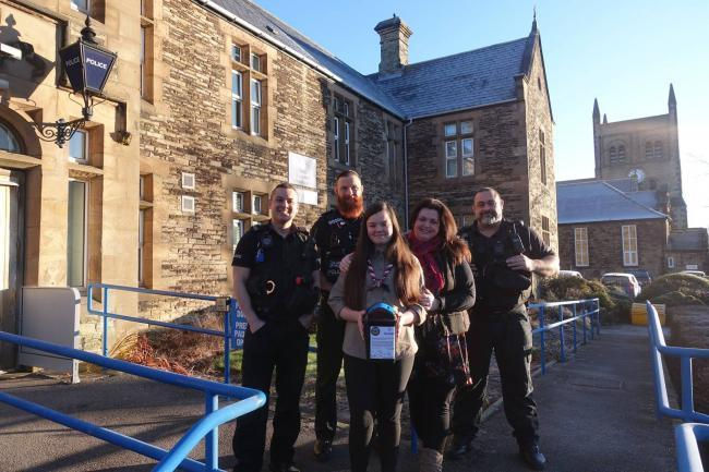 GENEROUS OFFICERS: Pictured, from left, PC John Gordon, PC Carly Symes and PC Lee Jackson with Chloe and Katy Keogan at Consett Police Station in Parliament Street after they collected cash for the foreign trip.