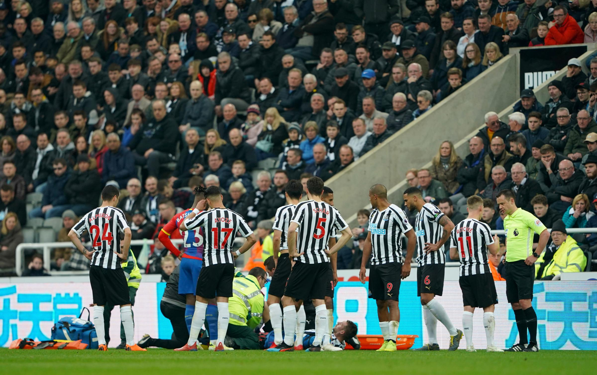 INJURY BLOW: Florian Lejeune receives treatment before leaving the field on a stretcher (Picture: Owen Humphreys/PA Wire)