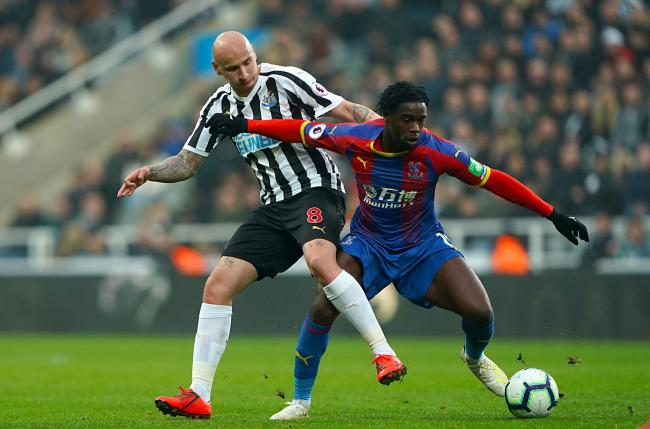 Newcastle United's Jonjo Shelvey (left) and Crystal Palace's Jeffrey Schlupp battle for the ball during the Premier League match at St James' Park, Newcastle. PRESS ASSOCIATION Photo. Picture date: Saturday April 6, 2019. See PA story SOCCER N