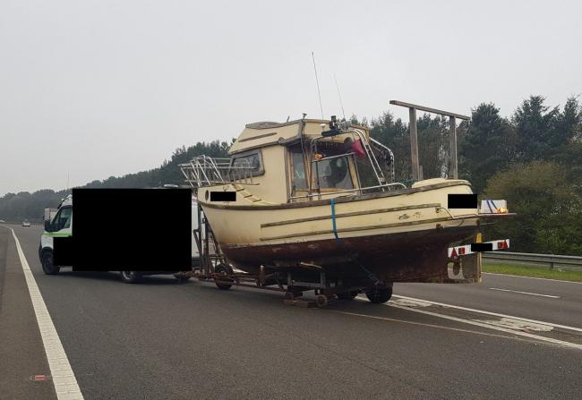 Handout photo taken with permission from the twitter feed of @HighwaysNEAST of a stranded boat, as traffic officers were left having to pray for rain and floods after a stranded boat caused the temporary closure of a slip road. Picture: PA