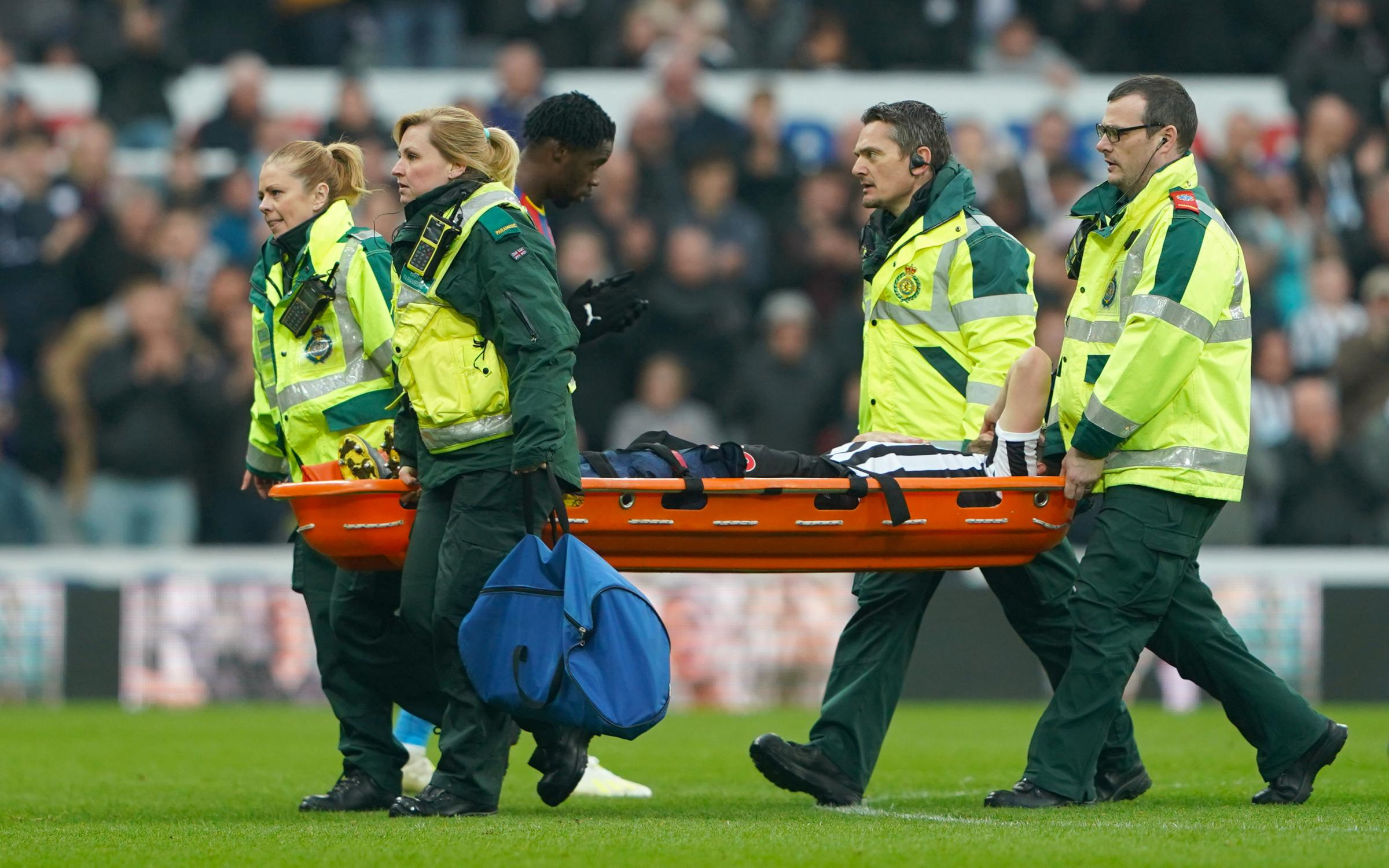 Newcastle United's Florian Lejeune leaves the pitch injured during the Premier League match at St James' Park, Newcastle. PRESS ASSOCIATION Photo. Picture date: Saturday April 6, 2019. See PA story SOCCER Newcastle. Photo credit should read: Owen