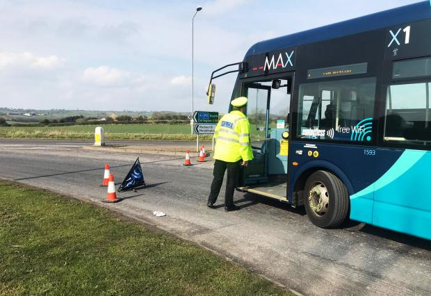 The Northern Echo: An officer speaks to an Arriva bus driver as traffic is diverted towards the A68
