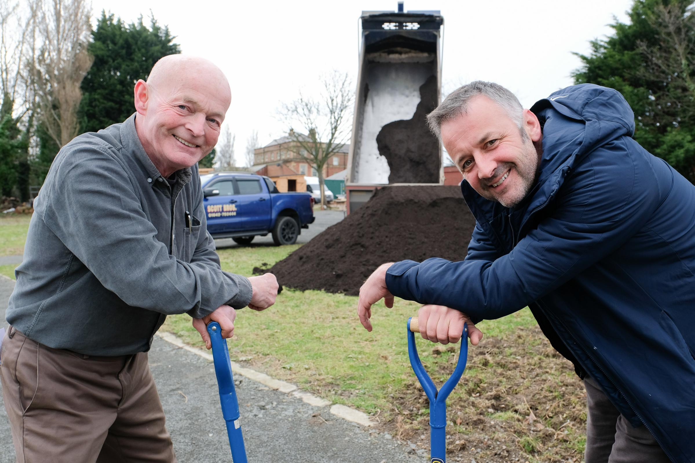 UNUSUAL DONATION: Francis Owens, left, of In Harmony Food Revolution CIC and Scott Bros. director Peter Scott help distribute the donated top soil