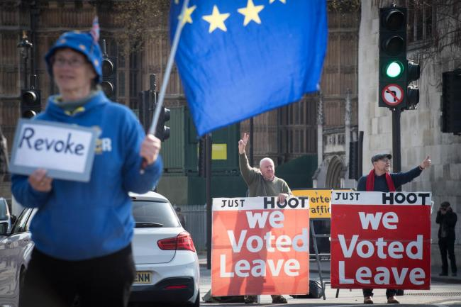 Leave and remain protesters outside the Houses of Parliament, London. Picture: Stefan Rousseau/PA Wire