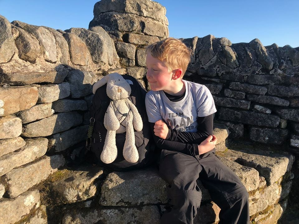 TOP: Noah Gray, seven, is the youngest person to do the Yorkshire Three Peaks