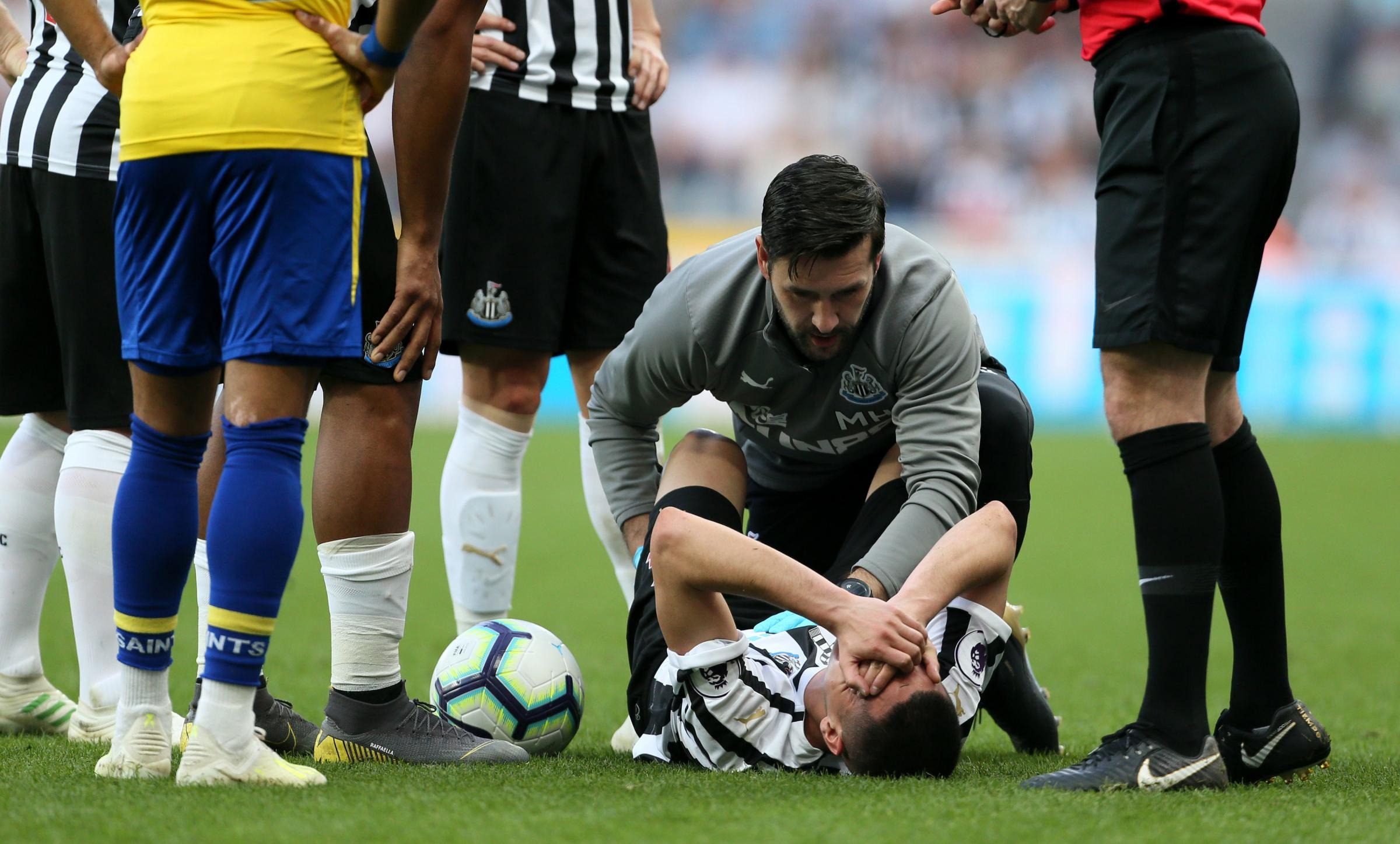 INJURY BLOW: Miguel Almiron receives treatment before leaving the field (Picture: Richard Sellers/PA Wire)