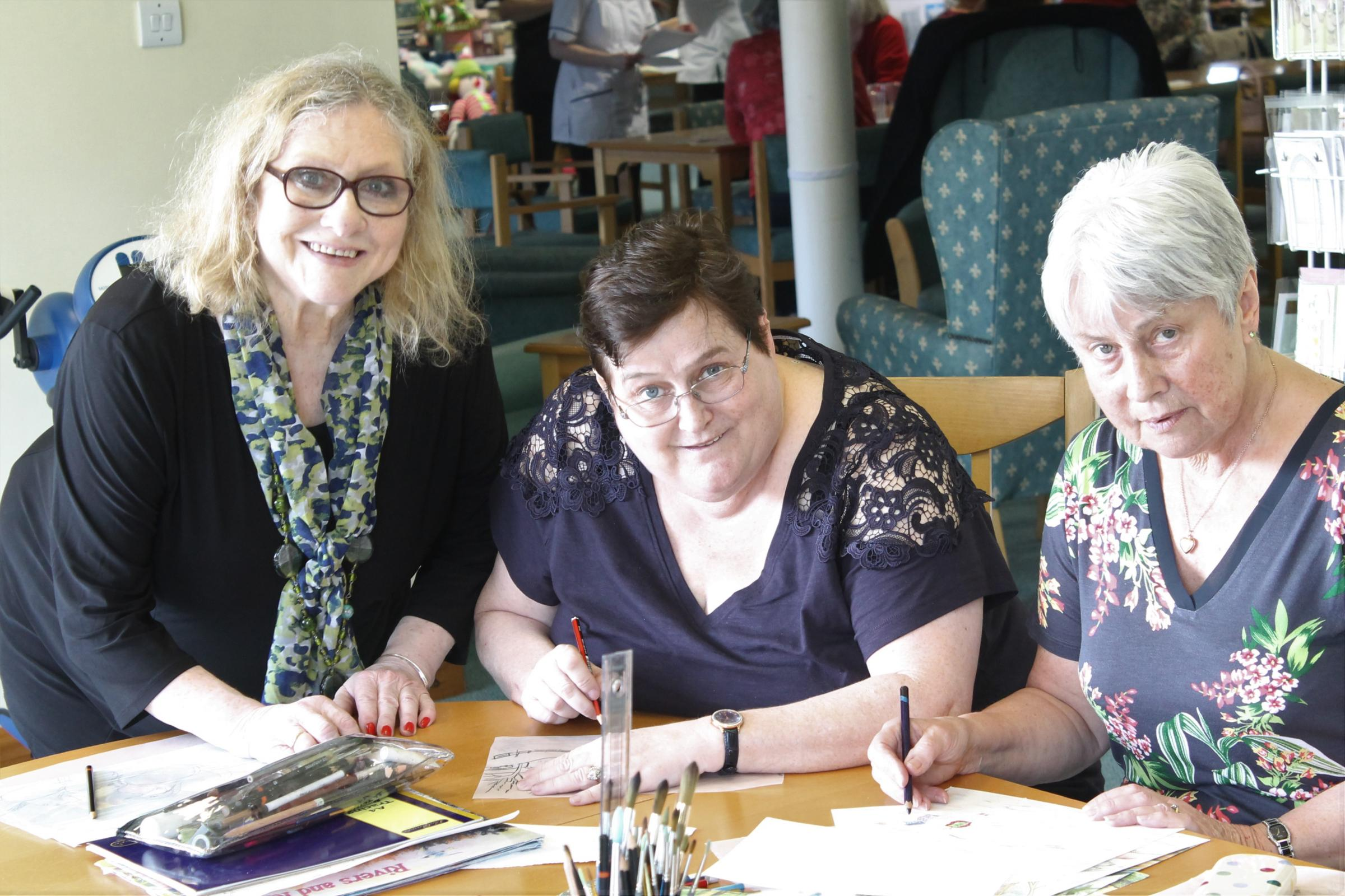 CREATIVE: Art teacher Alison Stafford with Sara Newton and Sue Sands. Pictures: Peter Barron