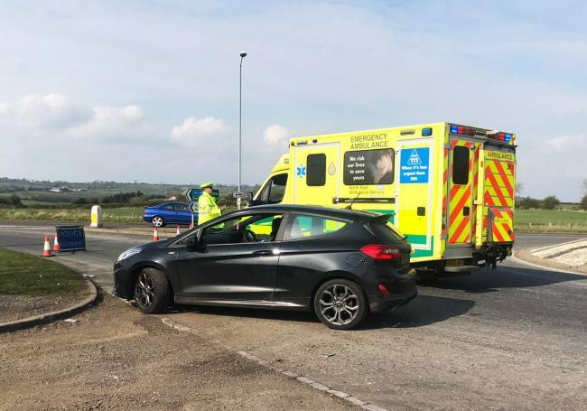 Police direct an ambulance to the scene of the crash and divert motorists towards the A68