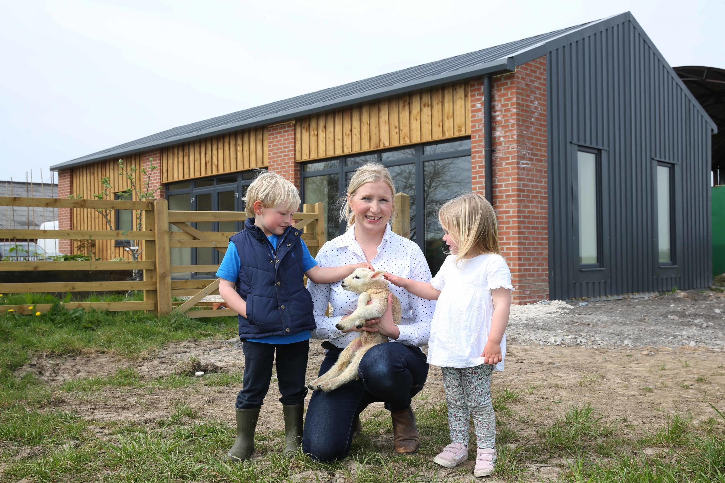 Lucy Atkinson who has set up a children's nursery on her farm at Scorton, pictured with Charlie Whittaker,4 and Charlotte Atkinson, 3. Picture: Richard Doughty Photography