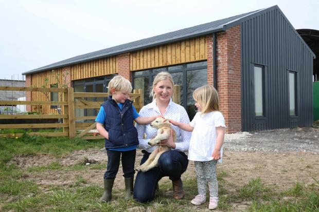 The Northern Echo: Lucy Atkinson who has set up a children's nursery on her farm at Scorton, pictured with Charlie Whittaker,4 and Charlotte Atkinson, 3. Picture: Richard Doughty Photography
