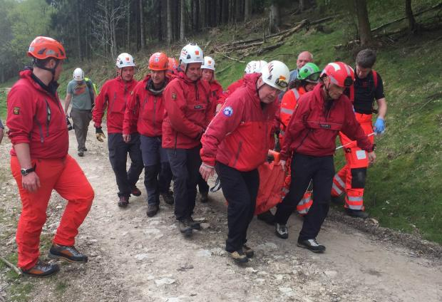 The Northern Echo: Cleveland Mountain Rescue Team and members of other North-East mountain rescuers carried the injured man along a remote forestry track. Picture: CMRT