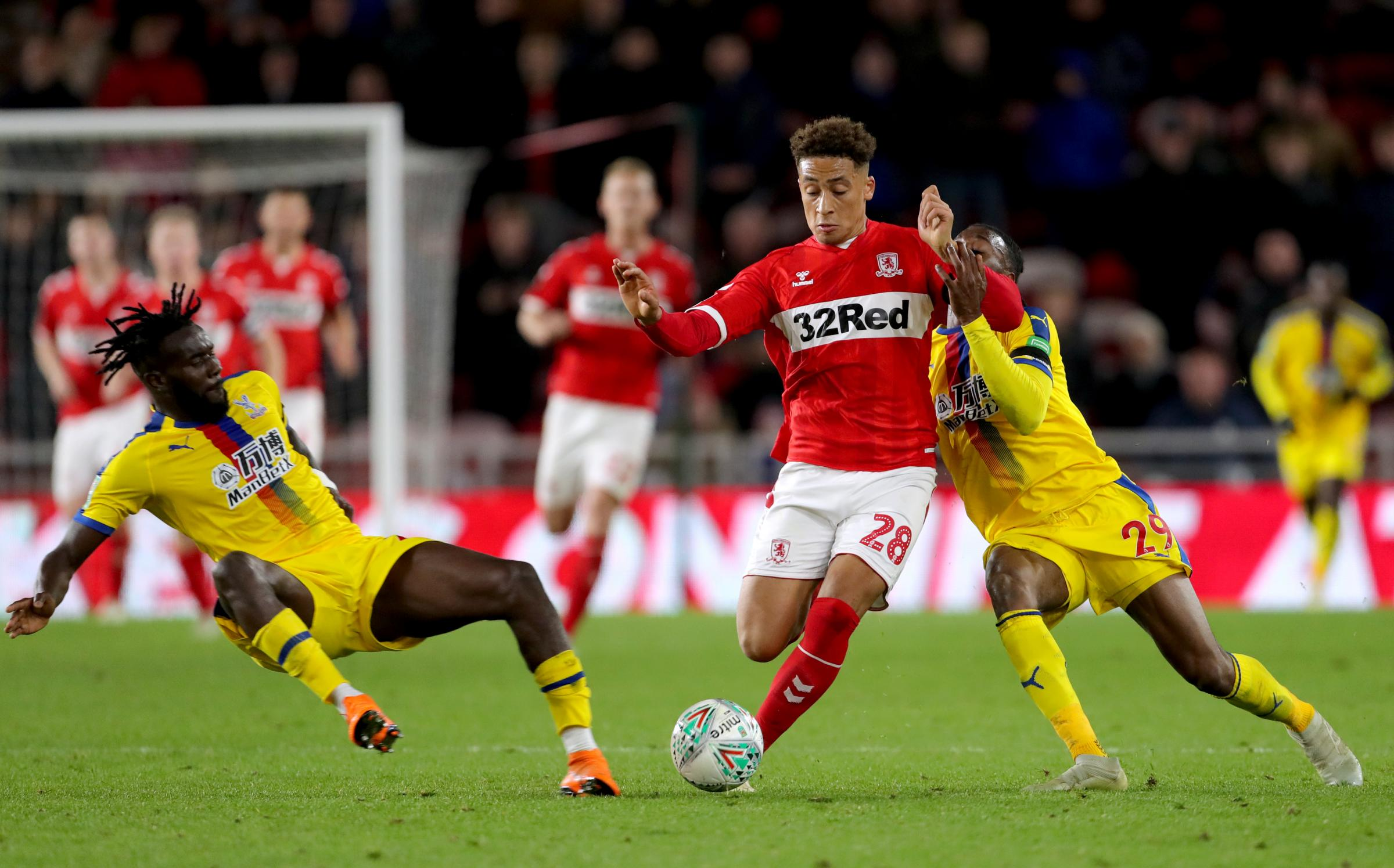 Middlesbrough's Marcus Tavernier (centre) battles for the ball with Crystal Palace's Aaron Wan-Bissaka (right) and Pape Souare during the Carabao Cup, Fourth Round match at the Riverside Stadium, Middlesbrough..