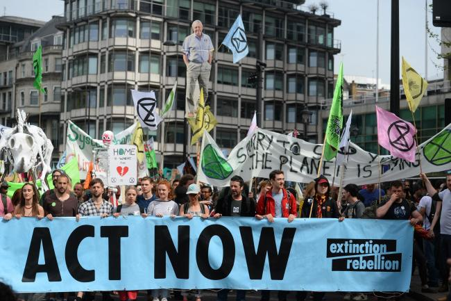 Extinction Rebellion protesters march from their camp in Marble Arch down Park Lane in London. Picture: Kirsty O'Connor/PA Wire