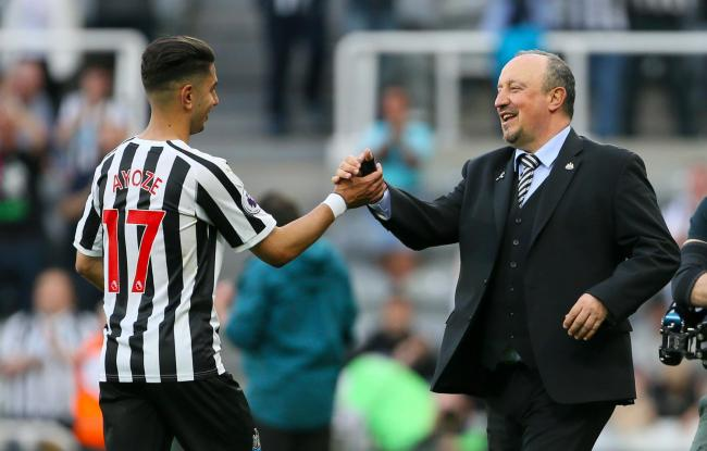 Newcastle United's Ayoze Perez celebrates with Newcastle United manager Rafael Benitez after the final whistle of the Premier League match at St James' Park, Newcastle..