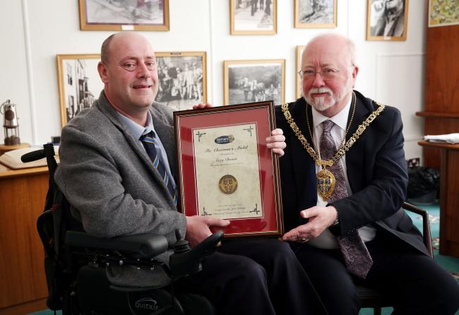 AWARD PRESENTATION: Gary Brown receiving his medal from Durham County Council chairman Councillor John Lethbridge