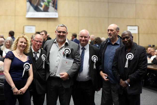 Newly-elected Newcastle First councillor Ian Donaldson (centre left) celebrates with other party members at the Newcastle City Council local election count