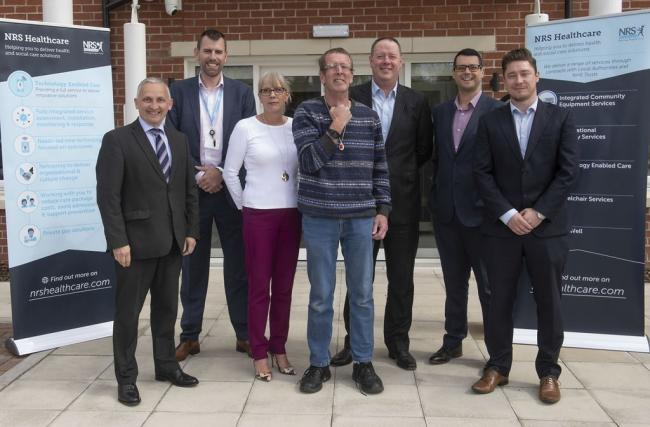 STAY SAFE: Tim (centre, wearing the tracker) with Cllr Michael Harrison (far left) and David Straughan, NRS, Managing Director National Care; Rebecca Dukes, North Yorkshire County Council, Housing Market Development Team; Nigel Thacker, NRS Development Di