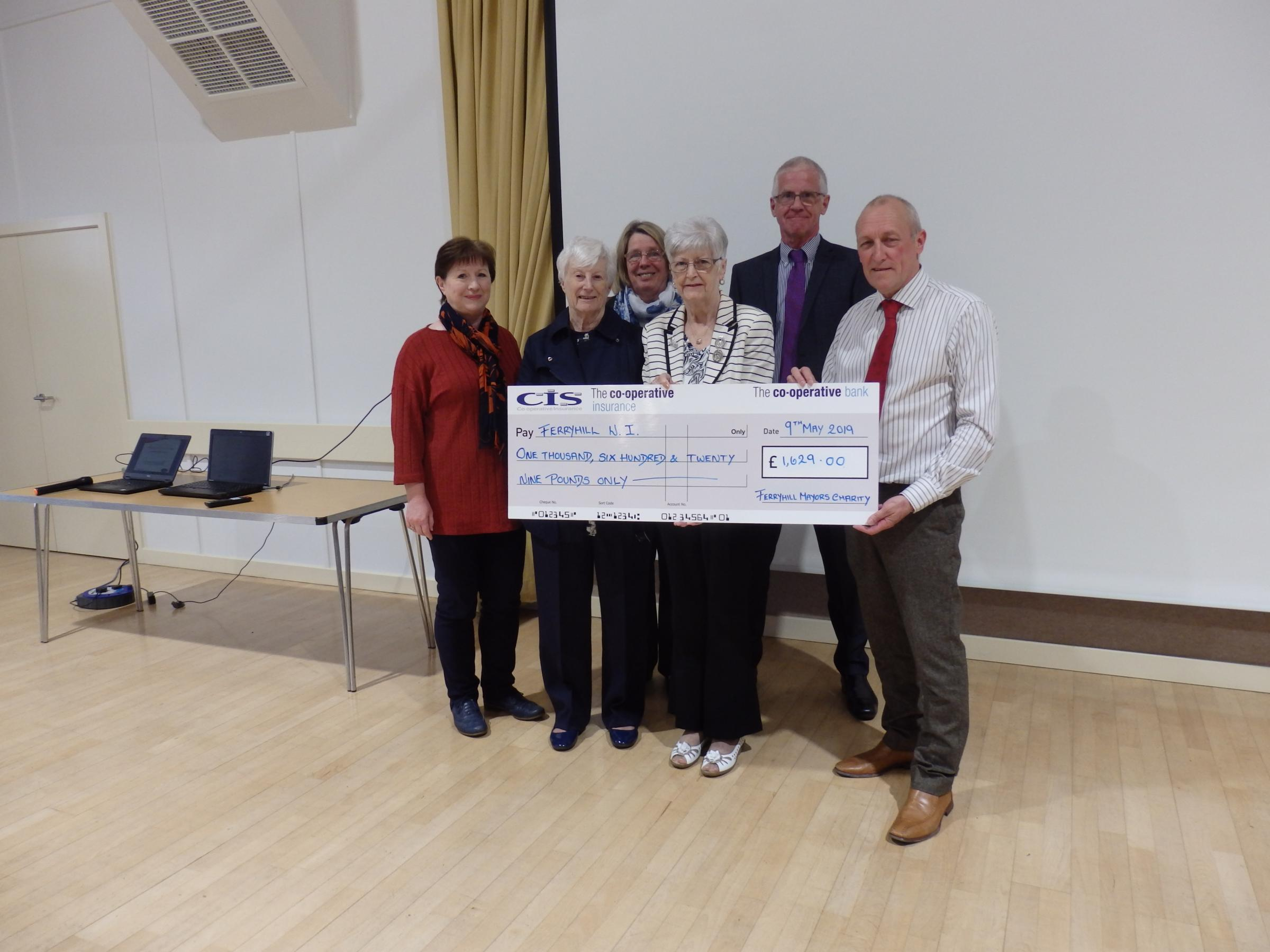 Ferryhill Mayor Dave Farry presents the proceeds of his year in office to Ferryhill WI, who shared it with Little rteasure Autism Group