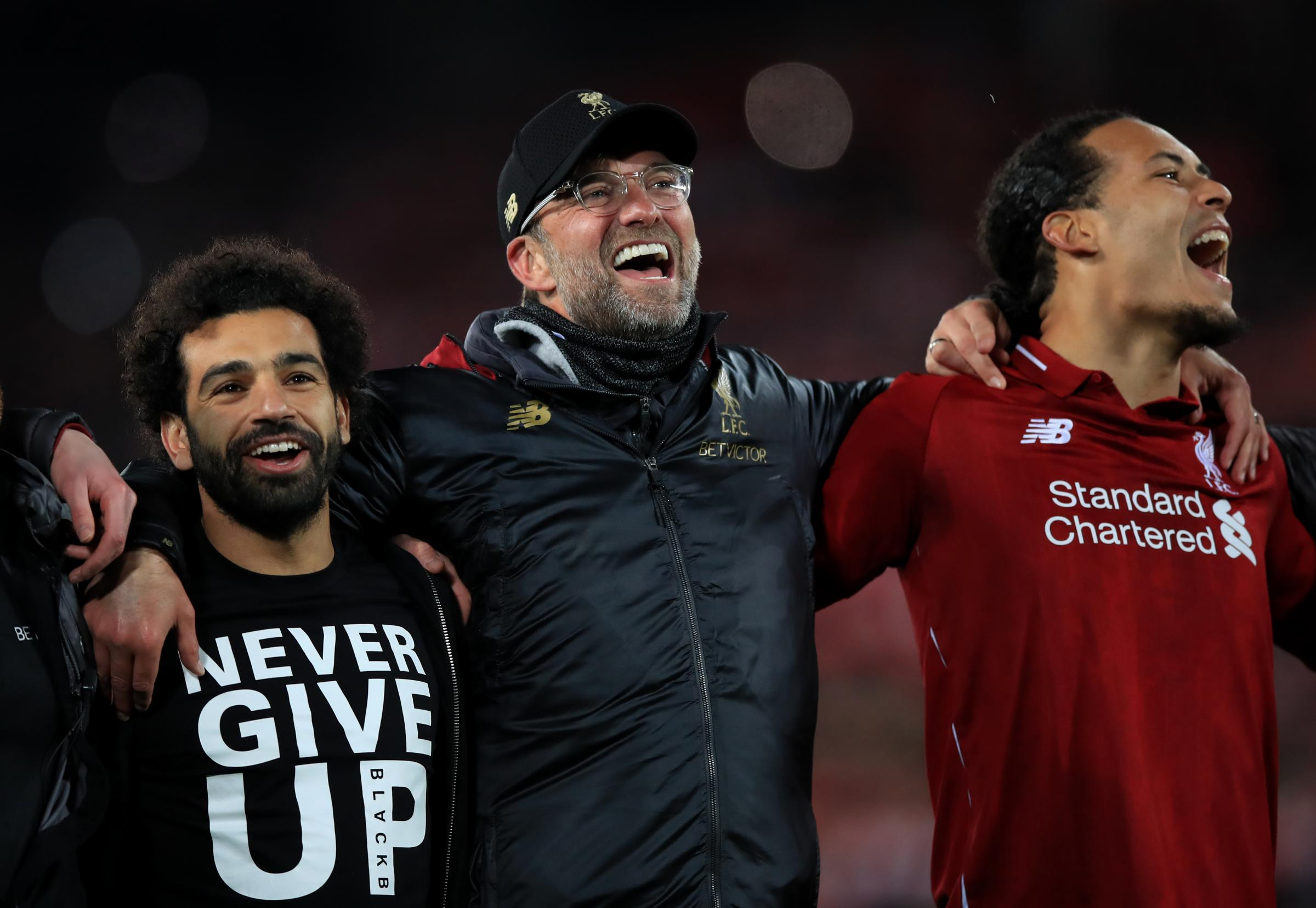 Liverpool's Mohamed Salah (left), manager Jurgen Klopp (centre) and Virgil van Dijk celebrate after the UEFA Champions League Semi Final, second leg match at Anfield, Liverpool. Picture: Peter Byrne / PA Wire