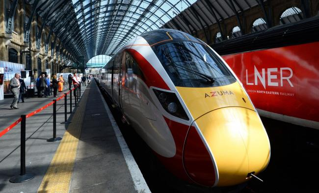 NEW: One of LNER's new Azuma trains departs platform eight at King's Cross station in London Picture: KIRSTY O'CONNOR/PA WIRE