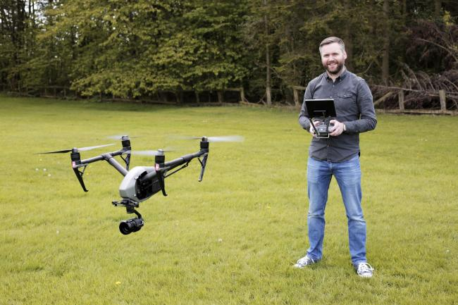 James McDermott with his drone. Photograph: Stuart Boulton