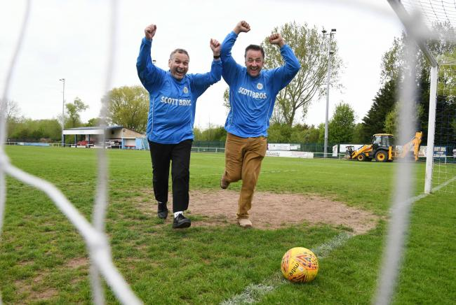 Thornaby FC secretary and treasurer Trevor Wing celebrates the club's promotion with Peter Scott as work continues to improve the ground's facilities