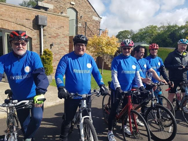 York House manager John Reay, second from left, with some of the cyclists taking part in the fundraising bicycle ride