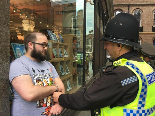 The Northern Echo: Paul Crowther, 32, from Throckley, Newcastle, speaks to police after Nigel Farage was hit with a milkshake in Newcastle city centre during a Brexit Party walkabout. Picture: PA