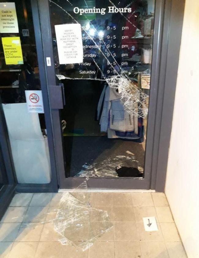 The door of the charity shop was smashed during the break-in