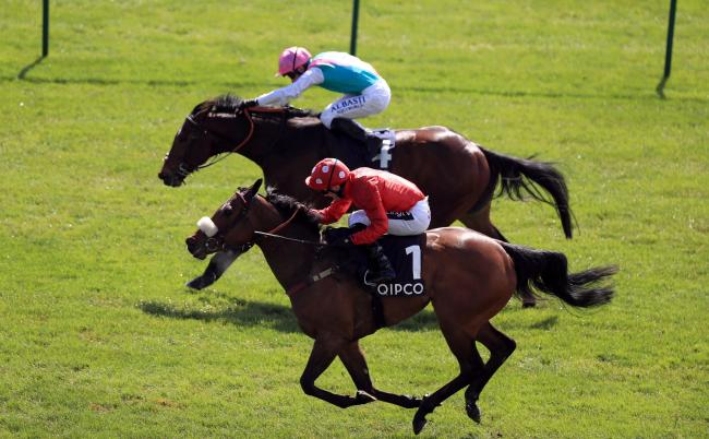 Mabs Cross ridden by jockey Paul Mulrennan (no.1) wins the Zoustar Palace House Stakes ahead of Equilateral ridden by Oisin Murphy (top) during day one of the QIPCO Guineas Festival at Newmarket