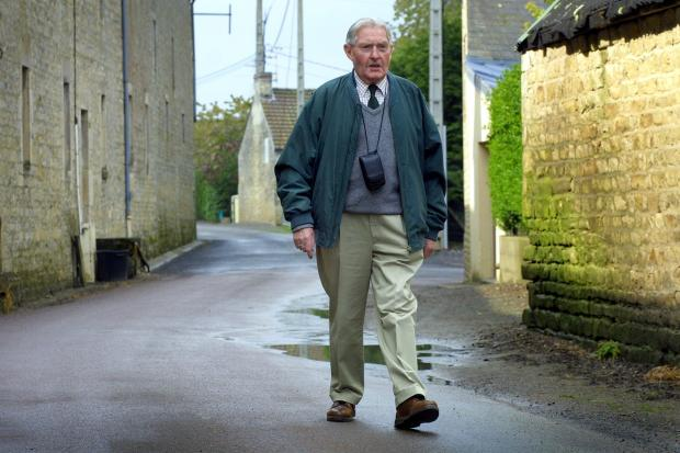 The Northern Echo: Major Ian English walking along Rue de Cristot in the village of St. Pierre for the 60th anniversary of D-Day