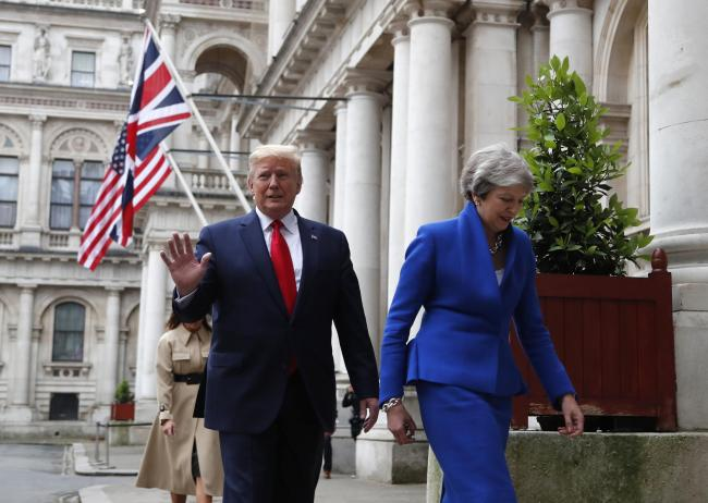 Prime Minister Theresa May and US President Donald Trump walk from Downing Street to take part in their joint press conference at the Foreign & Commonwealth Office, London, on the second day of his state visit to the UK. Picture: Frank Augustein/PA Wire