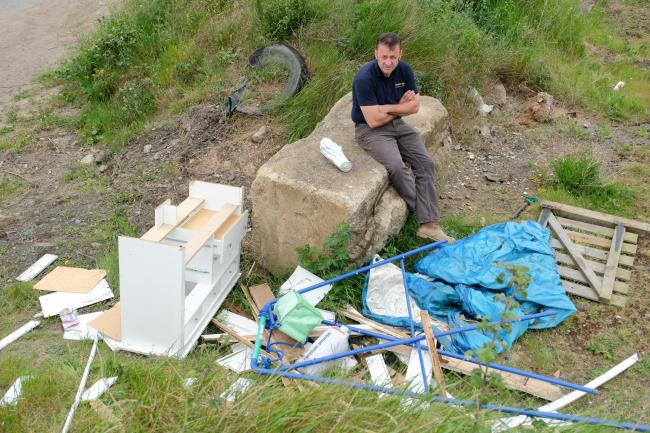 Peter Scott pictured with some of the recently dumped waste