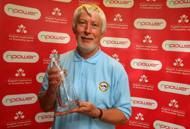 Keith Wilcox with his Service to Sport Award at the npower North East Disability Sports Awards  Picture: TOM BANKS