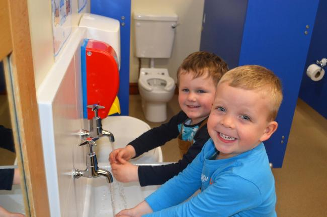 Charlie Walton (back) aged 4 and Lucas Walton, aged 3 in the new washroom in the pre-school room at High Bank Day Nursery.