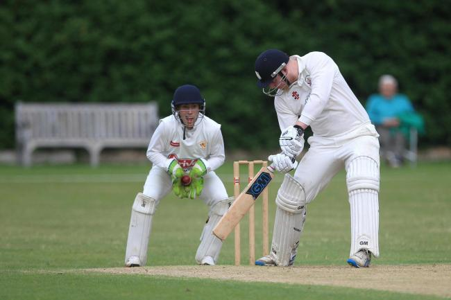 Billingham's Martin Cull gets one past the edge of David Seymour's bat into Billingham Synthonia's Elliot Holmes' gloves during the recent NYSD Premier Division match